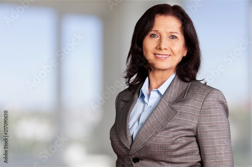 Fridge magnet Mature businesswoman wearing formal suit on background