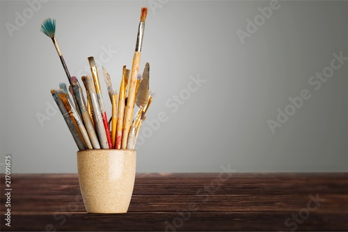 Brushes in a glass jar on the - 217091675