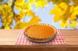 Leinwanddruck Bild - Home made pumpkin pie on autumn background