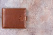 Brown leather wallet on background