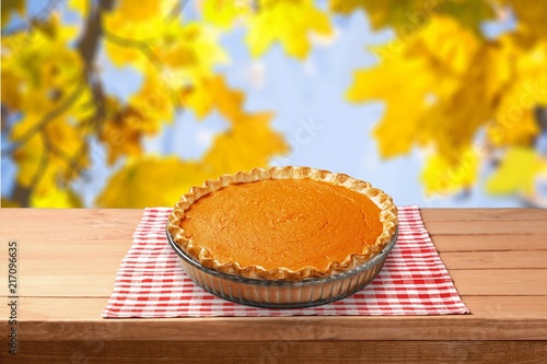 Leinwanddruck Bild Home made pumpkin pie on autumn background
