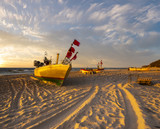 sunset on the sea beach, boats on the sand - 217101882