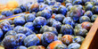 Crop of plums in boxes. Plum background. Beautiful blue plums close-up. - 217103237
