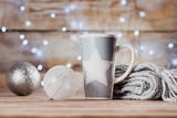 cup, Christmas toys and a gray scarf