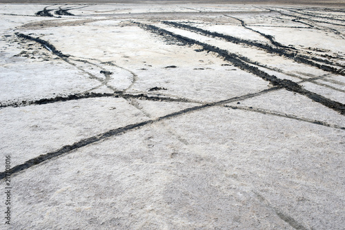 In de dag Stenen Car tire marks on the sand, mud in the island of Patmos, Greece in summer