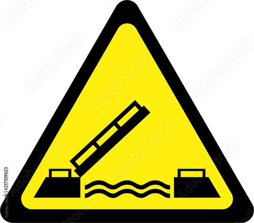 Leinwanddruck Bild Yellow warning sign with drawbridge