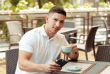 Young man using smartphone in cafe