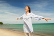 Quadro people and leisure concept - happy smiling woman on summer beach