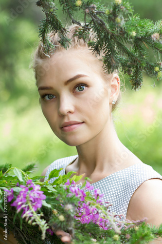 Foto Murales Portrait of a young girl with wildflowers