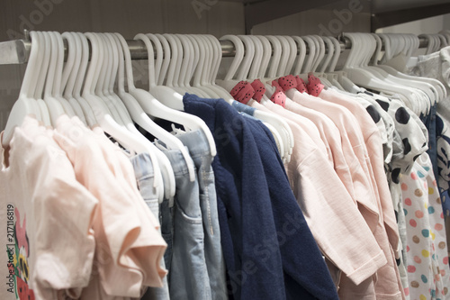 Photos of hangers with different fashionable clothes in the Department