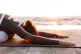 Strong young fitness woman stretching exercises. - 217117080
