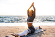 Strong young fitness woman stretching exercises.