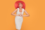 Middle age smiling woman in red summer hat. - 217134245