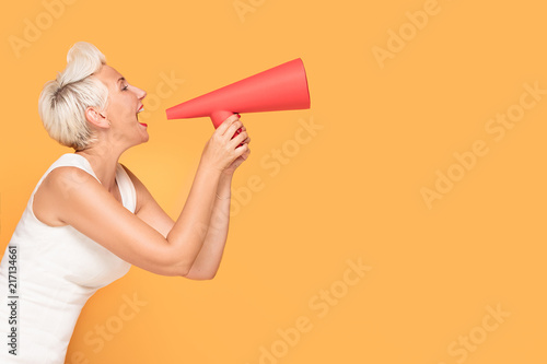 Middle age smiling woman with red megaphone. - 217134661