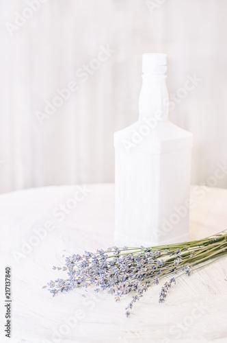 Foto Spatwand Lavendel Lavender flowers on a light coarse painted surface. Vintage style.