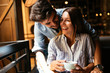 Quadro Young attractive couple on date in coffee shop