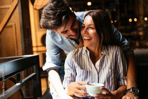 Young attractive couple on date in coffee shop - 217140088