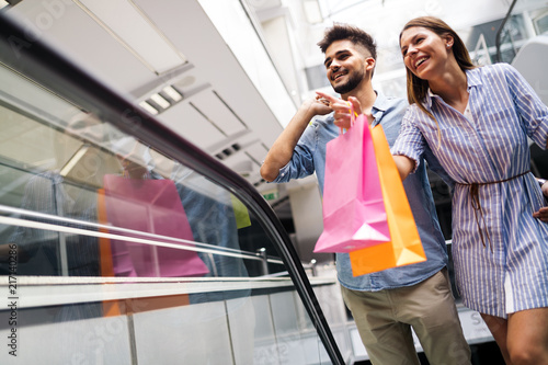 Leinwanddruck Bild Happy attractive loving couple enjoy shopping together