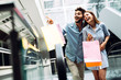 Leinwanddruck Bild - Happy attractive loving couple enjoy shopping together