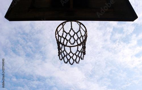 Foto Spatwand Basketbal basketball basket seen from below, blue and white sky