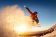 Leinwandbild Motiv Snowboarder jumps sunset with snow dust