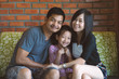 Quadro Portrait Of Asian Family smilling and hugging with love.