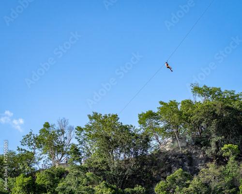 Foto Murales Man ziplining in the Mexican jungle