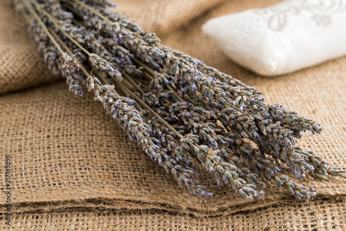 A branch of dried lavender on sackcloth - 217169896