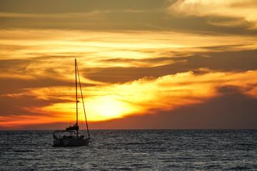 koh kood beach thailand, sunset boat orange sky people on boat, kayaking silhouette