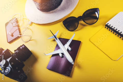 Foto Murales time to travel. traveler accessories on yellow background