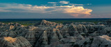 Sunset over Badlands National Park with thunderhead in the background