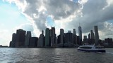 View of Lower Manhattan, NY from Brooklyn Bridge Park. Also a ferry crossing across the river. - 217210813