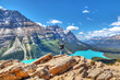 Hiker on Bow Summit overlooking Peyto Lake in Banff National Park
