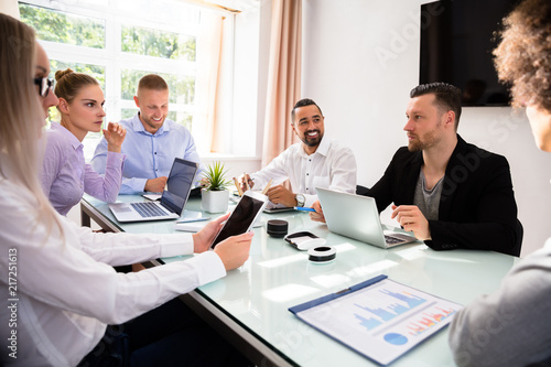 Leinwandbild Motiv Group Of Businesspeople Sitting In Office