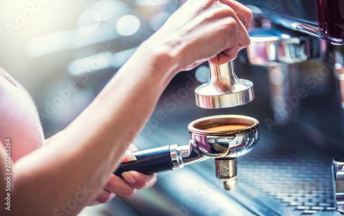 Sticker Barista woman making an espresso coffee.