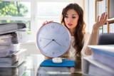 Businesswoman Holding Clock - 217263466