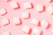 White marshmallow on pink background