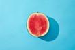Leinwanddruck Bild - top view of fresh ripe sweet halved watermelon on blue