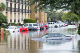 Cars submerged  in Houston, Texas, US during hurricane Harvey. Water could enter the engine, transmission parts or other places. Disaster Motor Vehicle Insurance Claim Themed. Severe weather concept - 217277618