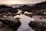low tide river leading to rocks and the ocean - 217280669