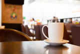 Mug of coffee on table with in cafe. - 217282064