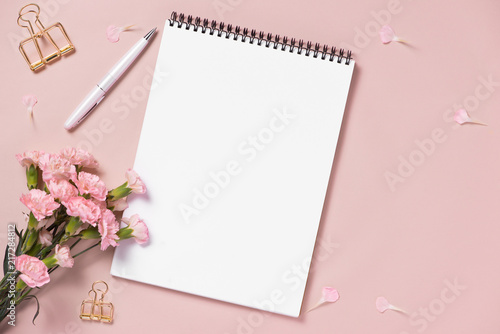 Leinwanddruck Bild Top view note book anf flowers on the desktop. For wedding planner concept