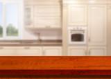 Kitchen, background. Empty textured wooden table and kitchen window shelves blurred background - 217290835