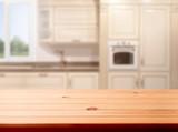 Blurred kitchen interior and desk space. Mock up - 217290893