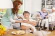 Leinwanddruck Bild - Friendly nurse supporting smiling senior woman in nursing house