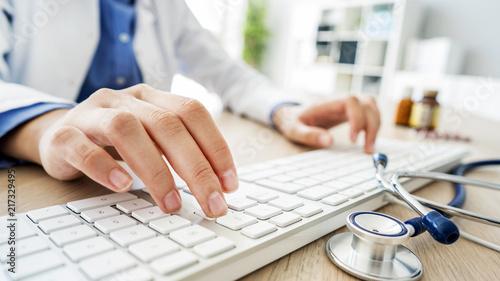 Female doctor typing on computer © sebra