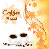 Two cups of hot coffee on the autumn background