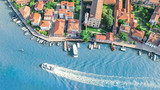 Aerial view of Murano island in Venetian lagoon sea from above, Italy