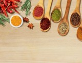 Various colorful spices on wooden table - 217354057