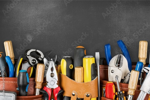 Tool belt with tools on wooden background - 217362432